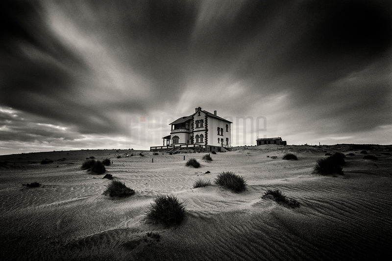 Desert Landscape and Abandoned House at Dawn