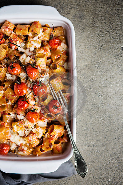 Baked pasta with tomato sauce and parmesan cheese