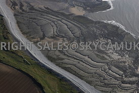 Aberthaw aerial photograph of the geological features caused by the action of water showing the worn and erode volcanic rock shelving of  the Aberthaw Welsh Coastline