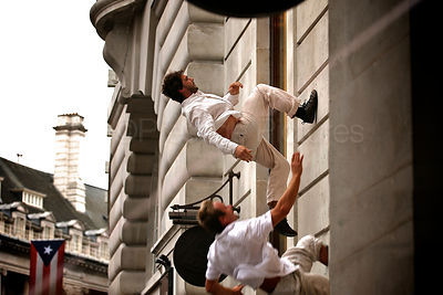 Performers from CRYING OUT LOUD  Running up the Side of a London Building