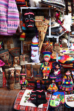 Dolls and other souvenirs for sale in Pisac market, Sacred Valley, Peru