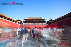 Crowd of people walking to the entrance of forbidden palace, Beijing, China