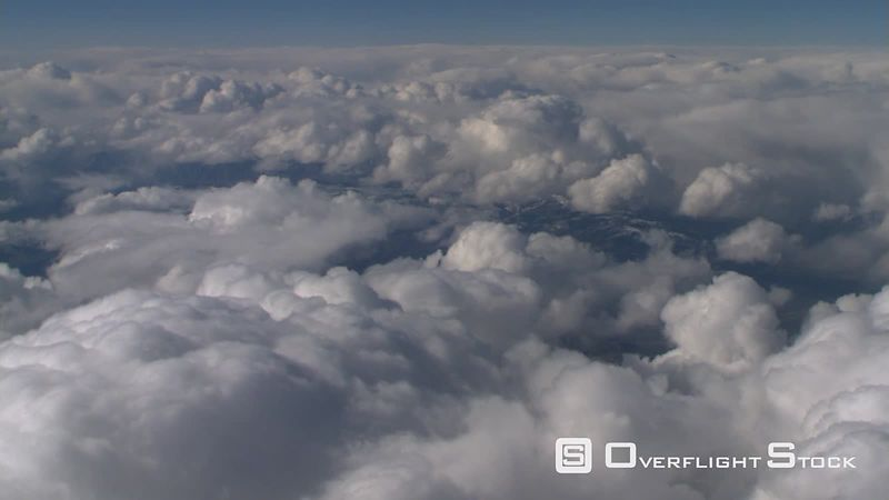 Flying through frame-filling cumulus, passenger POV