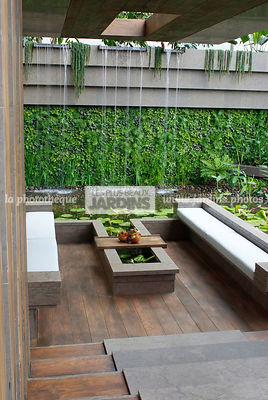 Chair, Contemporary furniture, Contemporary garden, Exotic garden, Garden construction, Garden furniture, Low table, Tropical garden, Contemporary Terrace, Wooden Terrace, Foliage wall, Green wall, Vegetation wall