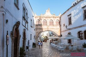 Tourists walking in Ostuni (the White town), Apulia, Italy