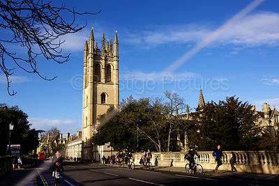 Magdalen College Tower in Oxford and Cyclists crossing the Magdalen Bridge