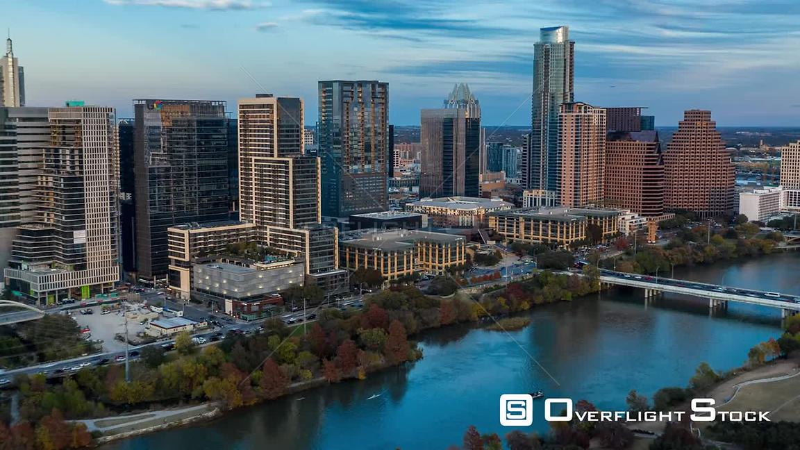 Low fly over lady bird lake with view of cityscape buildings in downtown Austin, Texas.