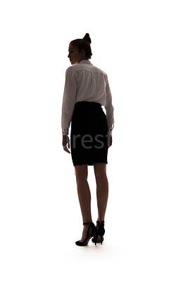 A woman, in silhouette, walking away – shot from low level.