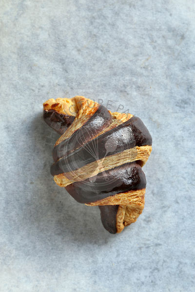 Bicolor french croissant on a baking paper.Top view