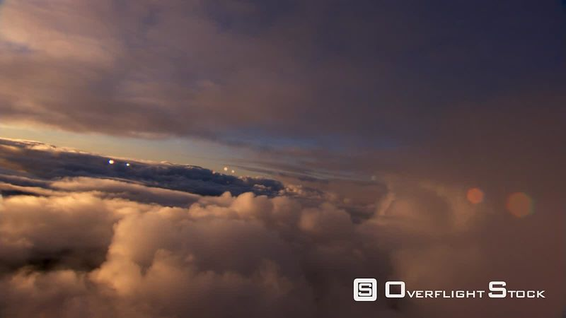 Flying over stratocumulus layer, with lens flares