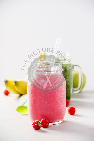 Close-up of pink fresh smoothie with fruits and berries selective focus. Detox, dieting, clean eating, vegetarian, vegan, fitness, healthy lifestyle concept