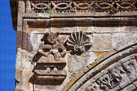 Detail of carving of person playing a violin on entrance archway of Nuestra Señora de la Asunción church, Juli, Puno Region, Peru