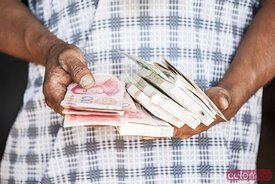 Close up of hands holding money, China