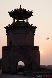 Tower on the ancient wall of Pingyao at sunset