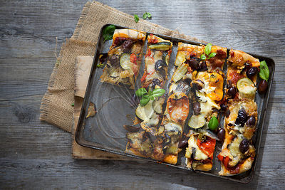 Homemade Roasted Vegetable Pizza with Olives, Basil and Peppers, Sliced