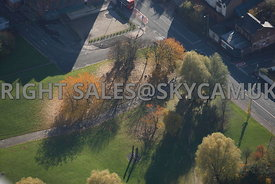 Manchester aerial photograph of Autumnal coloured trees in a small Manchester park