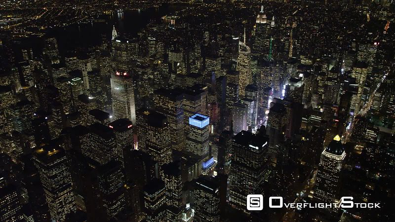 Flying southeast across Times Square and Midtown Manhattan at night.