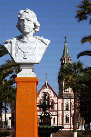 Monument to Christopher Columbus in Plaza Colon , San Marcos church behind, Arica, Region XV, Chile