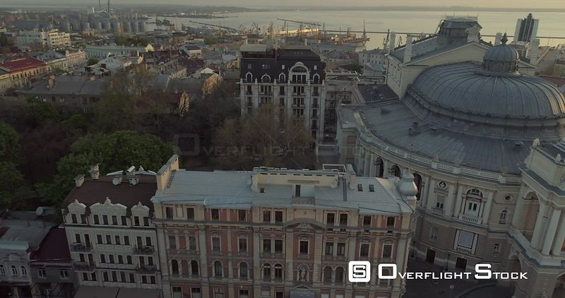 Aerial camera slowly tracks sideways the Odessa Opera Theatre with Odessa port in the background Ukraine