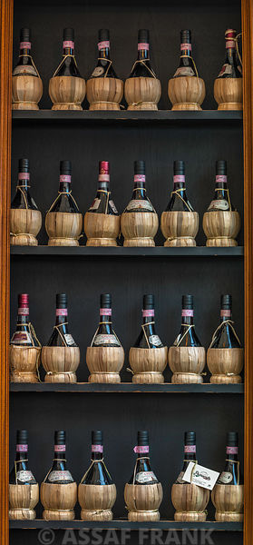 Old wine bottles on wooden shelf