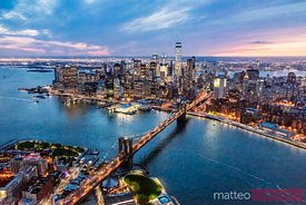 Aerial view of Brooklyn bridge and Manhattan at dusk, New York, USA