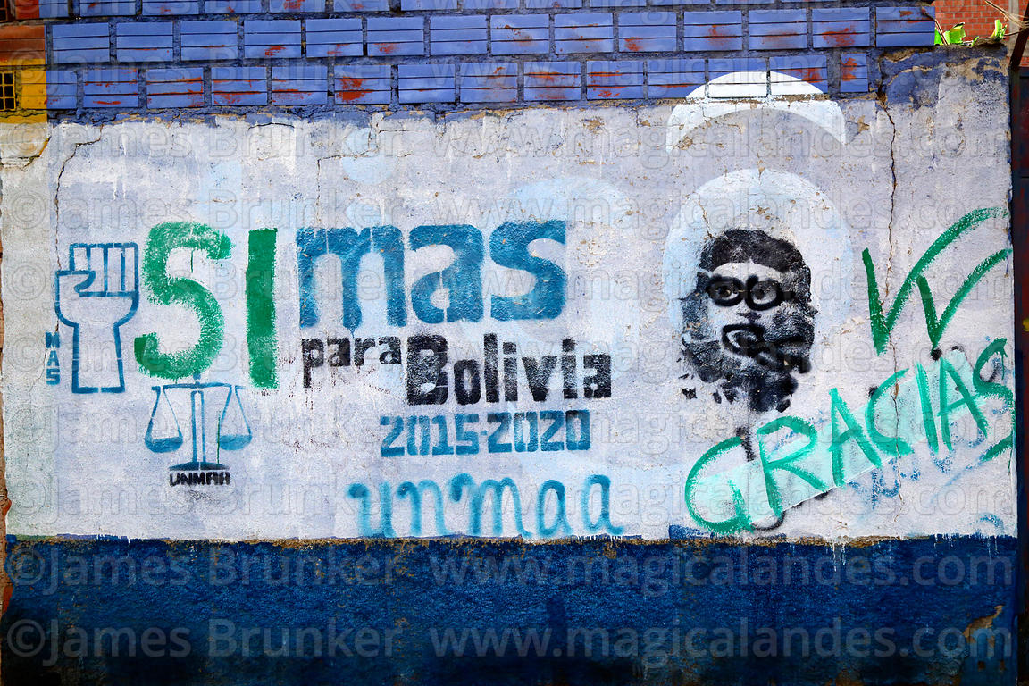 Defaced Che Guevara portrait and slogans on wall showing support for Movimiento al Socialismo MAS political party, El Alto, Bolivia