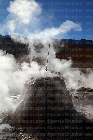Thermometer measuring temperature inside geyser at El Tatio geyser field, Region II, Chile