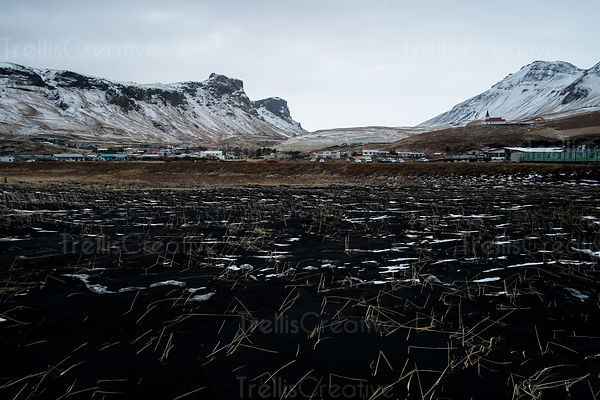 View of the town of Vik, Iceland from the black sand beach