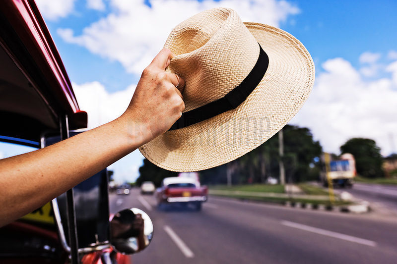 Tourist Waving Cuban Hat out of Car Window
