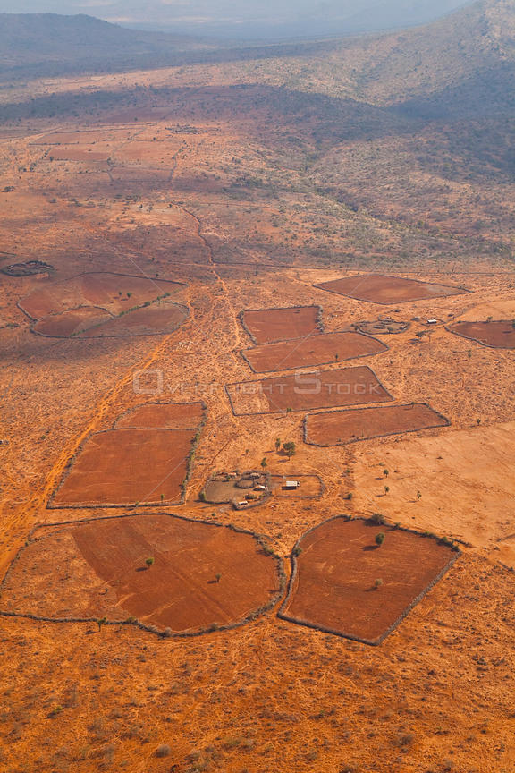 Aerial view of Maasai tribe homestead, with buildings and livestock enclosures. Rift Valley, Tanzania, Africa, August 2009