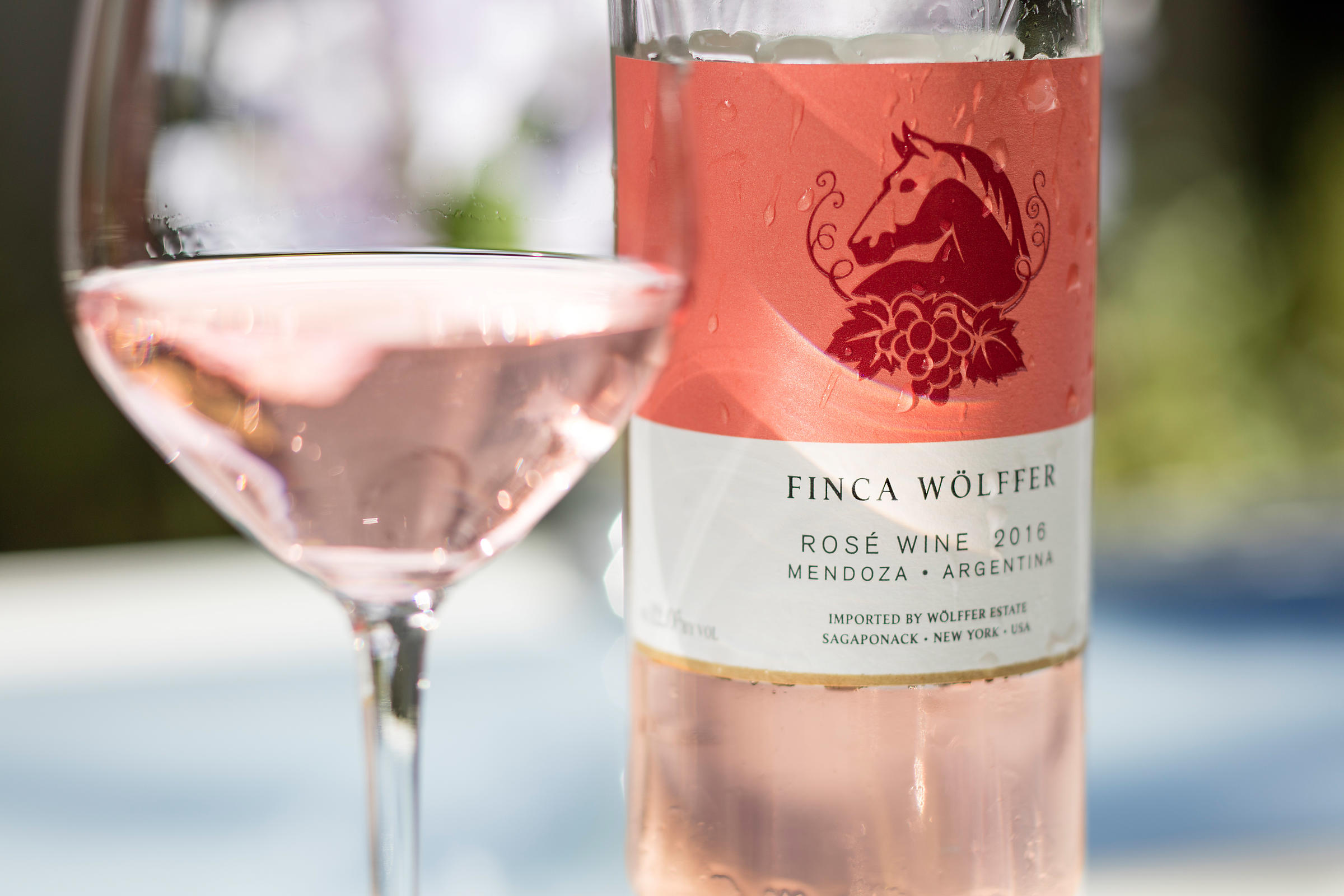 Wolffer Estate rose styled with wine glass. New York winery photographer Jason Tinacci