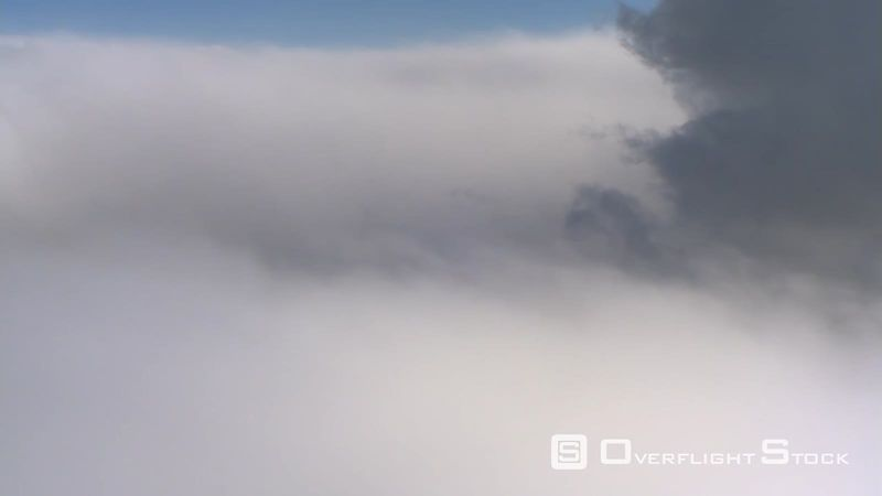 Flying through dense clouds blocking view, passenger POV