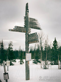 Wooden signs on cross-country ski tracks