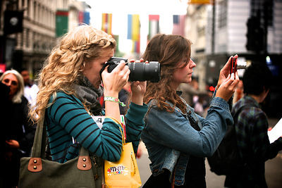 Two Young Women Photographing in the Street