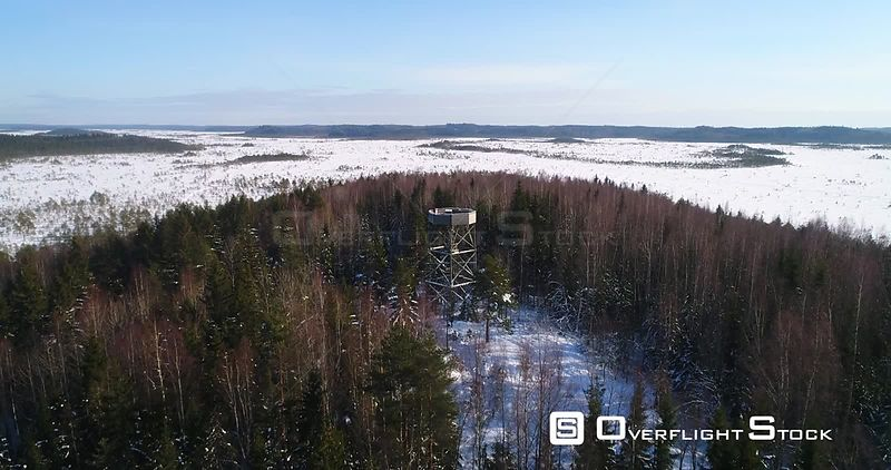 Watchtower, 4k Aerial View Over a Nature Observation Tower, a Forest and a Huge Swamp, Winter Day, Torronsuo National Park, Kantahame, Finland