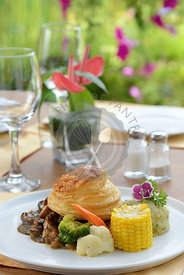 Chicken and Mushroom Pie with table setup in a restaurant