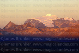 Full moon rising directly behind Mt Mururata (1 of a series of 4 images), Cordillera Real, Bolivia