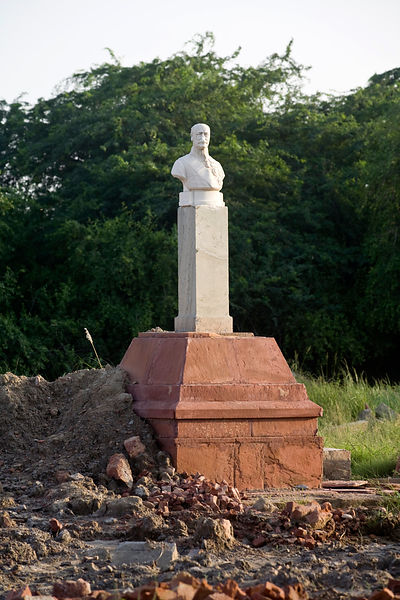 India - Delhi - Statue of Sir Guy Fleetwood Wilson sits alongside those of King George V and other Imperial notables and Viceroys at the Coronation Durbar site near Delhi, India. The statues were removed from New Delhi in the 1960's. The statue of George