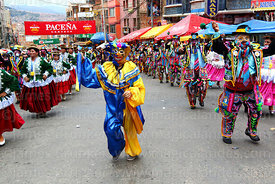 A pepino dancing with a group of cholitas and ch'utas during parades for the Entierro del Pepino, La Paz, Bolivia