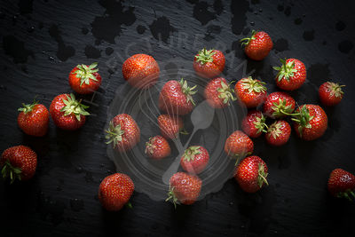 Strawberries on black slate. Top view.