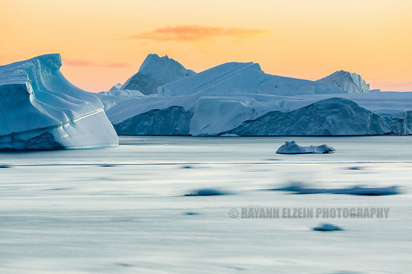 Long exposure at sunset of the icebergs of the Ilulissat Icefjord