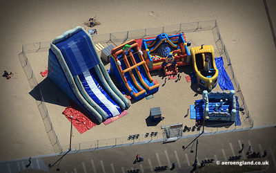 aerial photograph of bouncy castles on the beach at  Great Yarmouth.