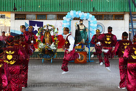 Morenos dance group dancing in honour of saints at St Peter and St Paul festival, Arica, Chile
