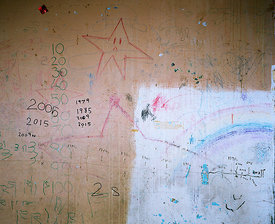 Child's drawings and timeline history of Barry Jackson Toweron wall of recently vacated flat 119,  on the top floor of Barry Jackson Tower after compulsory purchase order.