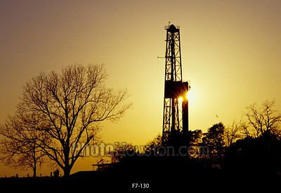 Texas oil derrick at sunset