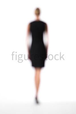 A Figurestock abstract image of a walking blonde woman in a little black dress – shot from mid level.