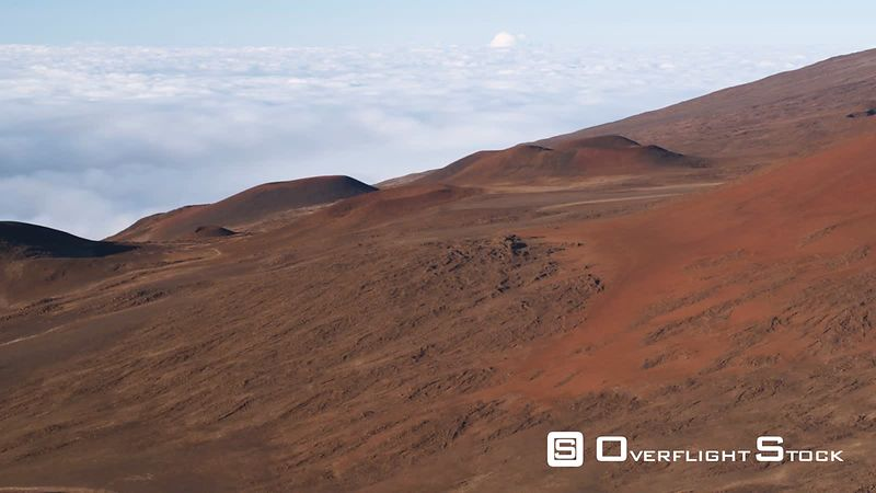Flying down a red slope of Mauna Loa, Hawaii.