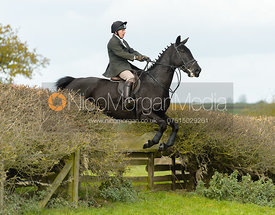 Albany Mulholland jumping a fence near Gartree Covert