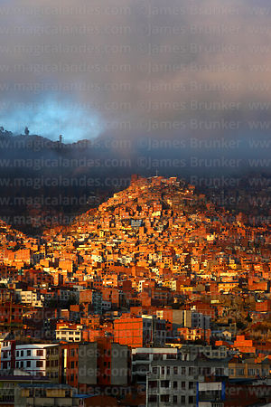 Clouds over brick houses on hillside in suburb of La Paz, Bolivia