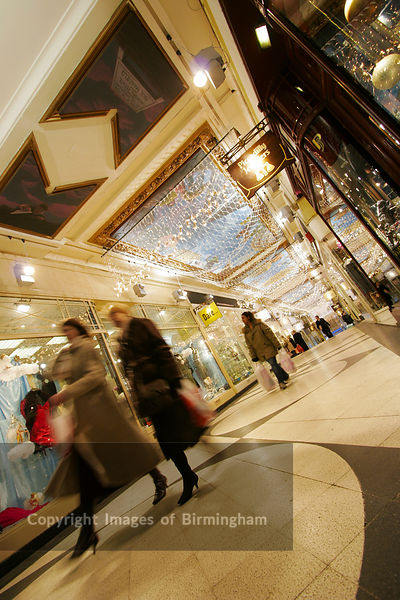 Shopping Arcade, Birmingham City Centre. Retail outlets at Christmas time.